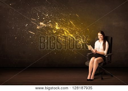 Businesswoman with tablet and energy explosion on background concept