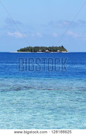 Seascape with small island.