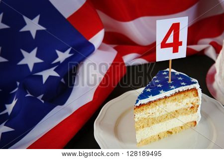 Piece of cake with USA flag. 4th of July concept.