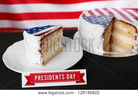 Piece of American flag cake, on black wooden table. President's day concept.