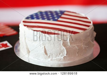 American flag cake, on black wooden background.