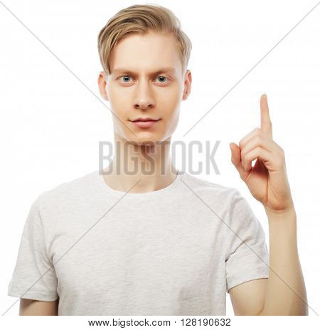 Young happy man with good idea sign in casuals looking at camera