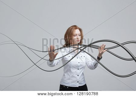 Woman with electrical cables or wires, curved lines