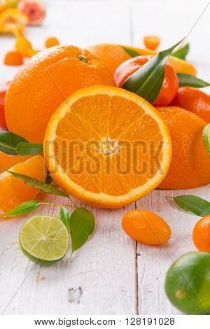 Fresh oranges on a wooden table, close-up.