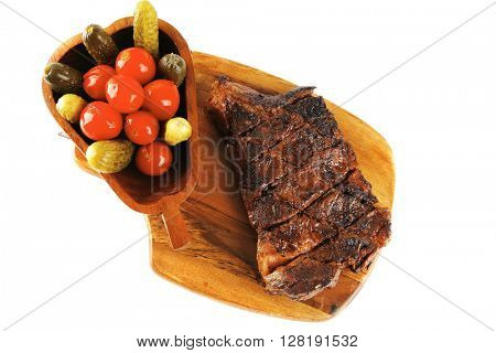 grilled steak antrecote and vegetables on wooden plate isolated over white background