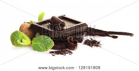 Chocolate with mint and nuts on white background
