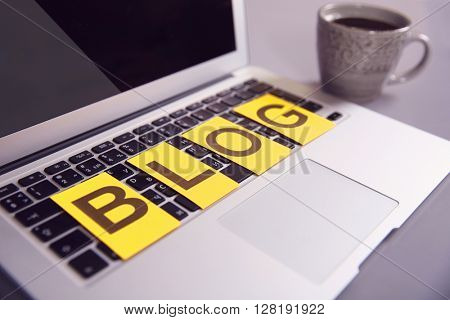 Internet blog concept. Word blog on keyboard.