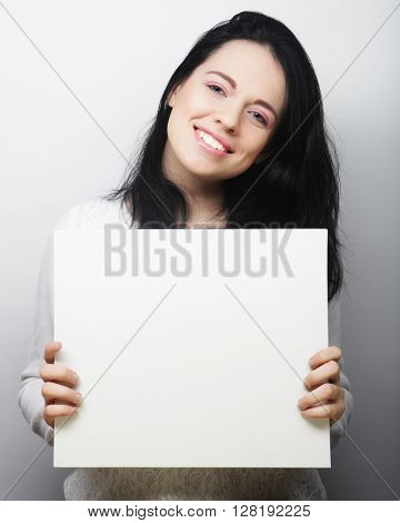 casual style woman showing blank signboard