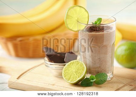 Fresh banana cocktail with chocolate and fruits on cutting board