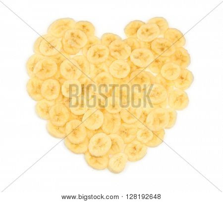 Banana slices folded in the form of heart, isolated on white