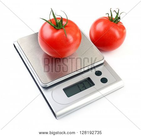 Two tomatoes with digital kitchen scales, isolated on white