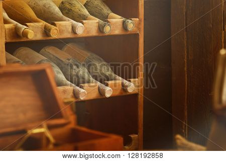 Aged wine bottles in a wine cellar
