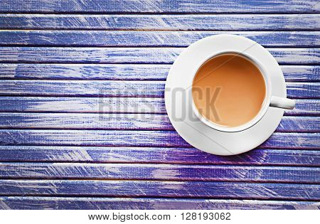 Milk tea on purple wooden background.
