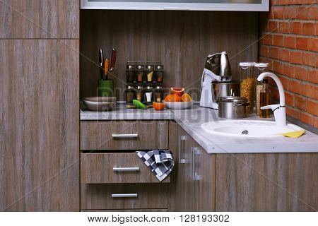 Modern kitchen furniture with sink, mixer and utensils