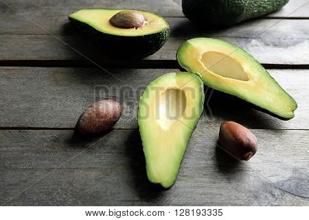 Sliced avocado on wooden table