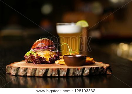 Fresh burger on a wooden board.
