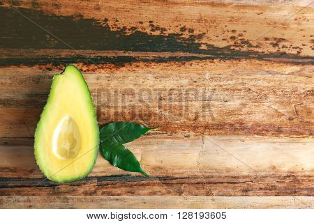 Fresh avocado  on wooden table, top view