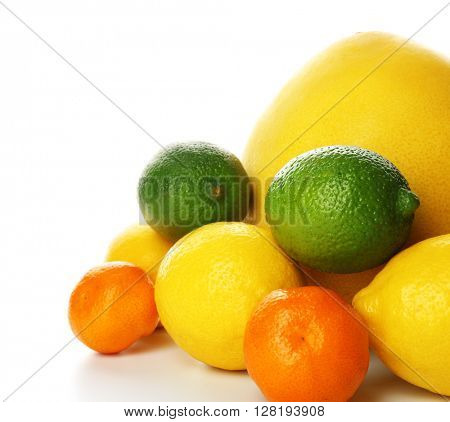 A heap of mixed citrus fruit including   lemons, limes, tangerines and pomelo isolated on a white background, close up