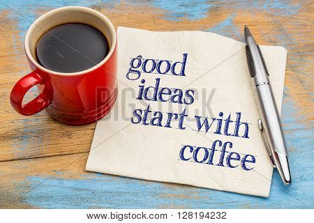 Good ideas start with coffee - handwriting on a napkin with a cup of coffee