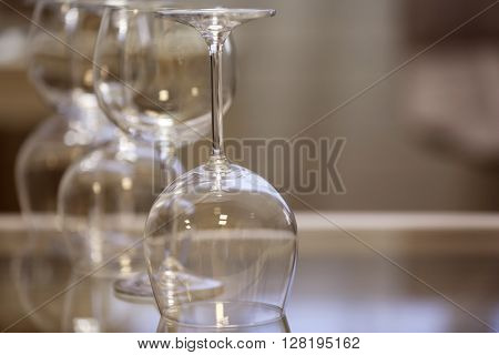 Upturned wine glasses on the table