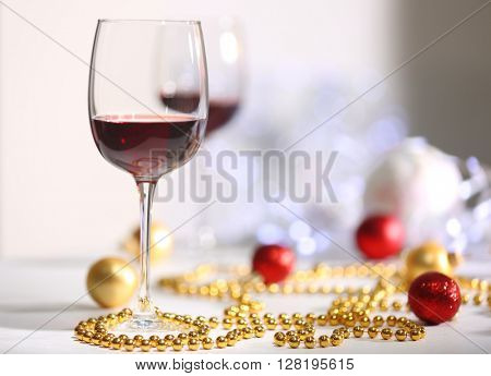 Wineglasses on light blurred background