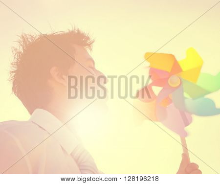 Businessman Blowing Wind Summer Power Energy Concept