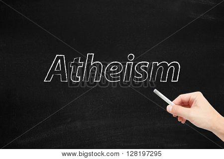 Atheism written on a blackboard