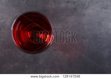 Glasses with red wines on grey table, copy space