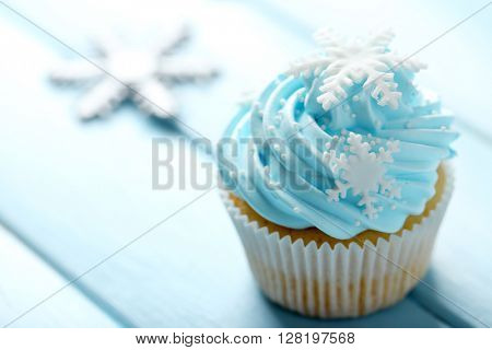 Blue cupcake on wooden background