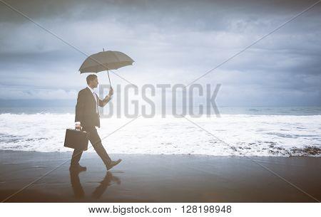 Businessman facing storm.