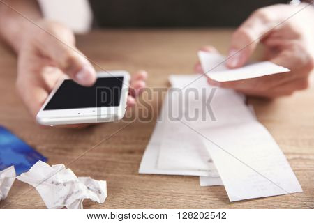 Male hands using calculator apps at the table