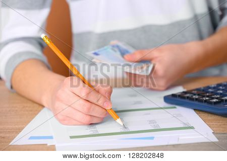 Man working on financial report at the office, close-up