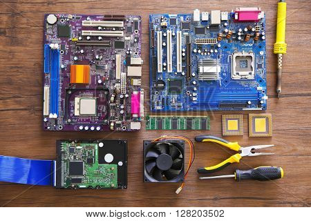 Electronic circuits on wooden table, top view