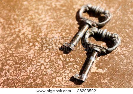 Vintage keys on a brown background