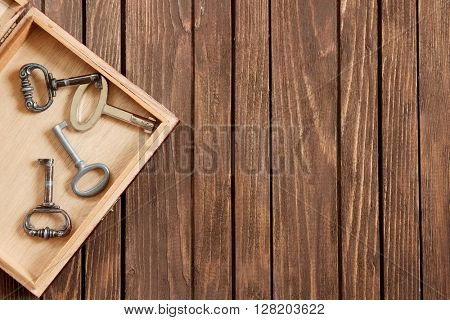 Vintage keys in a wooden box.
