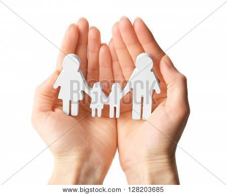 Cutout figurine of a family in female hands isolated on white