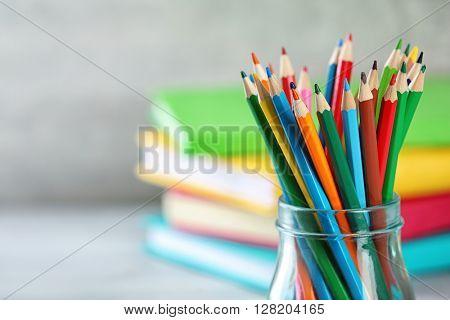 Pencils in glass jar, closeup