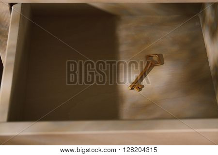 Golden key in drawer