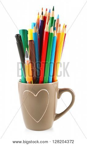 Colorful stationery in cup, isolated on white
