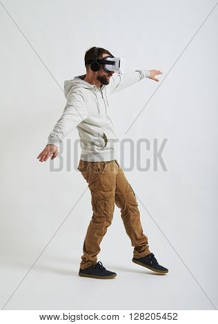 The picture in virtual reality glasses seems so real to the young man that he carefully minds his step