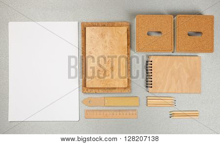 Office set with white sheet of paper, notebooks and stationery on grey background