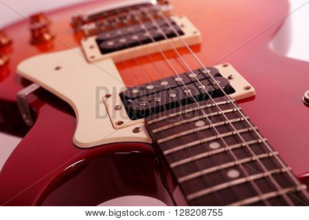 Electric guitar on white background, close up
