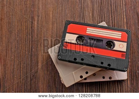 Old audio cassettes on wooden background