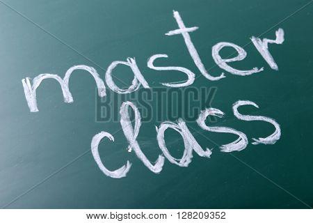 Master class inscription written with white chalk on blackboard