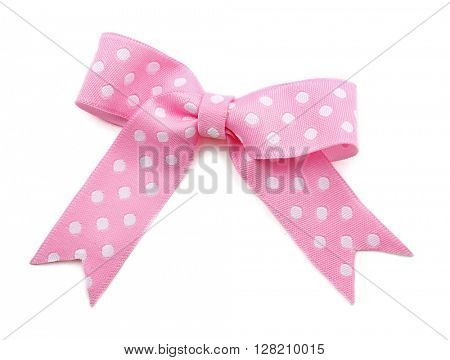 Pink dotted bow isolated on white background