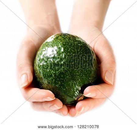 Female hands holding fresh avocado isolated on white