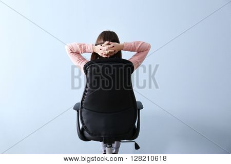 Woman sitting back on the office chair indoors
