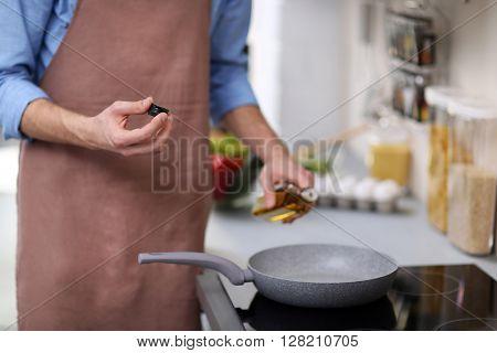 Man cooking in kitchen