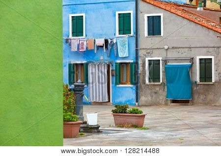 Colourfully painted house facade on Burano island province of Venice Italy