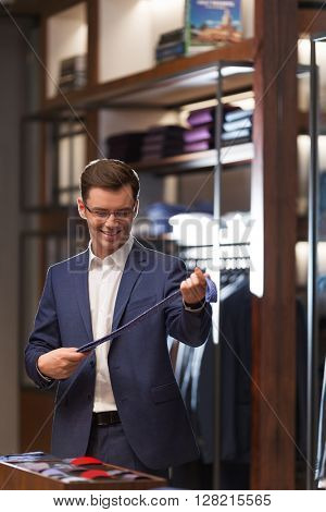 Smiling customer in a suit indoors